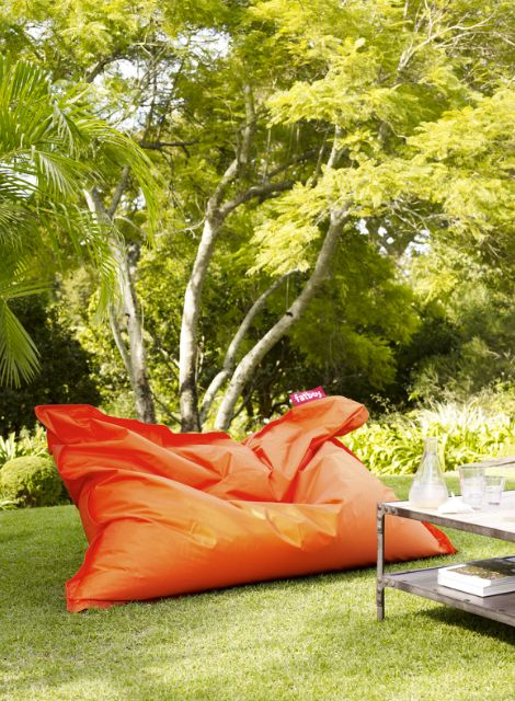 oversized bright orange bean bag seat instead of a sofa