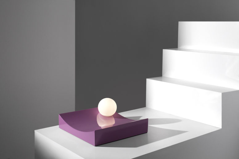 the lights appear to be rolling down sculptural geometric plinths