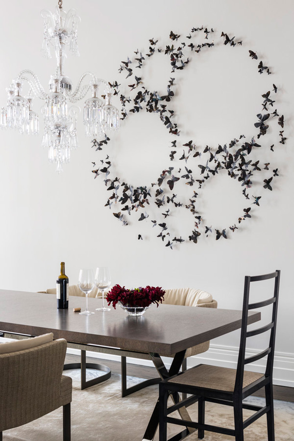 The dining area features a stunning butterfly installation on the wall