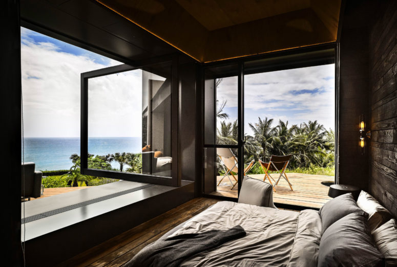 The master bedroom is all about adorable views, there's a glazed door and a glazed wall that can be opened outdoors