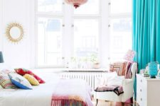 05 bold blue curtains, colorful bedding and a blush lamp look fresh