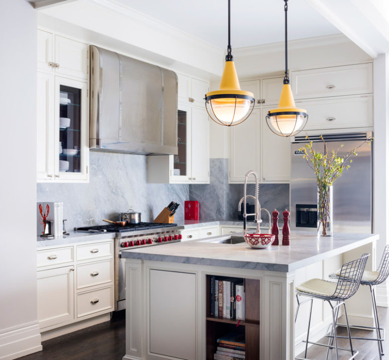 The kitchen is done in cream and grey marble, which create a cozy and chic ambience