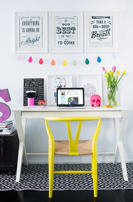 a bold banner and a neon yellow chair to give a fresh feel to the space