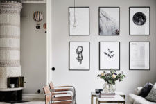 07 Brown leather chairs and black and white artworks add eye-catchiness to the space
