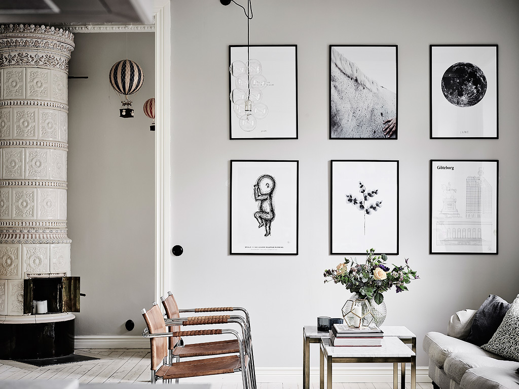 Brown leather chairs and black and white artworks add eye catchiness to the space