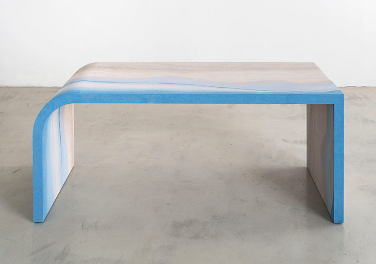 Escape desk shows the bold blue and neutral tones in its design