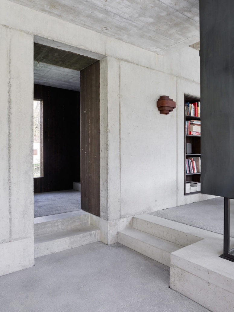 The combo of rough concrete and dark wood looks very textural and eye-catching