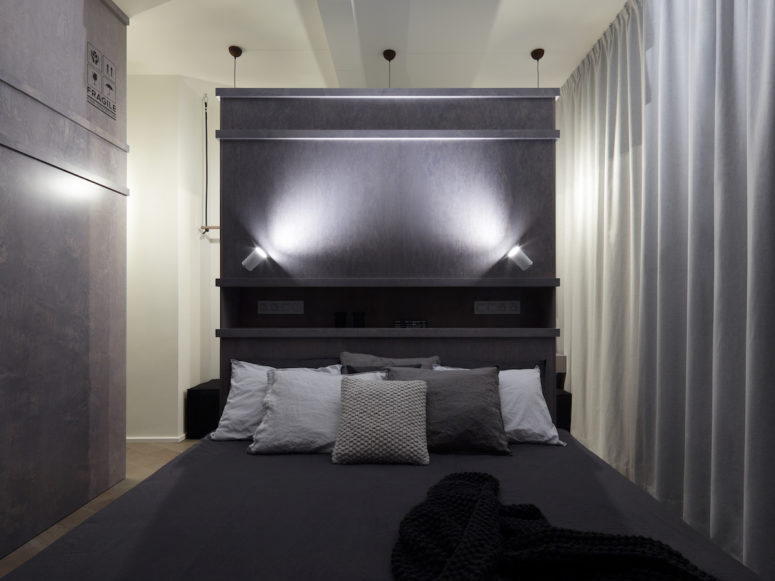 The darker accents allow the bedroom and bathroom to feel particularly relaxing and comfortable