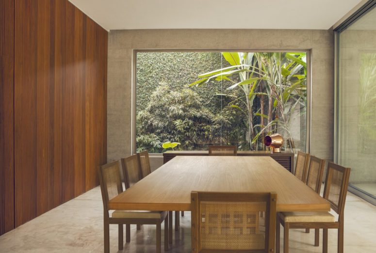 The dining space features a large table and some wooden chairs plus a gorgeous view