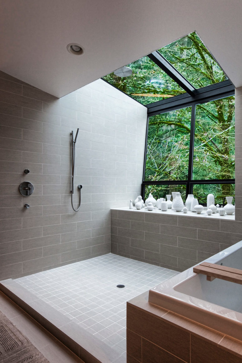 This cutout with a skylight in the shower area makes you feel having a shower outside but it's totally private