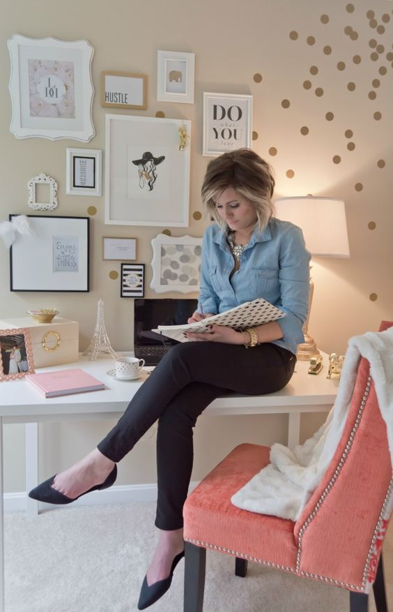 a coral chair, a gold polka dot wall and artworks