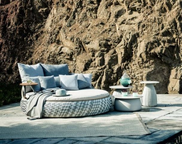 comfy round seating with a table and done in sea-inspired shades