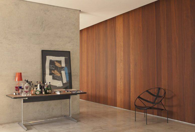 A slatted wooden wall in a rich shade makes the space cozier and softer