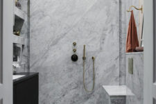 08 The bathroom is small, clad with white marble and with brass fittings for a chic look