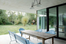 08 The terrace is simple, with sky blue seats and a rustic wooden table