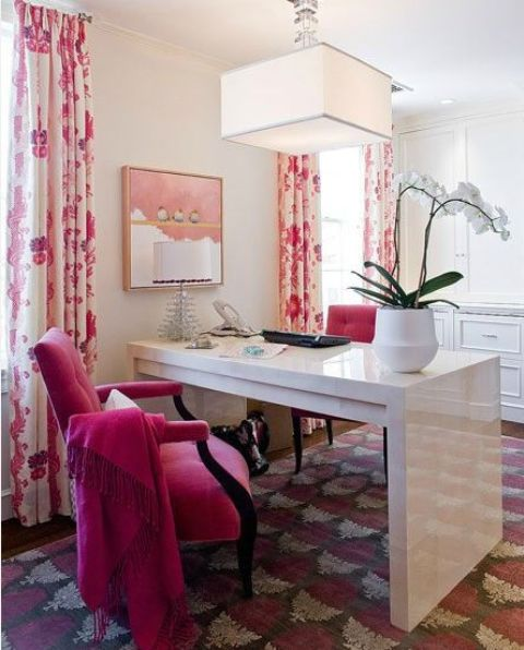 a hit pink velvet chair and floral curtains for a bold look