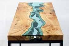 08 a wooden dining table with a blue glass insert that highlights its imperfections