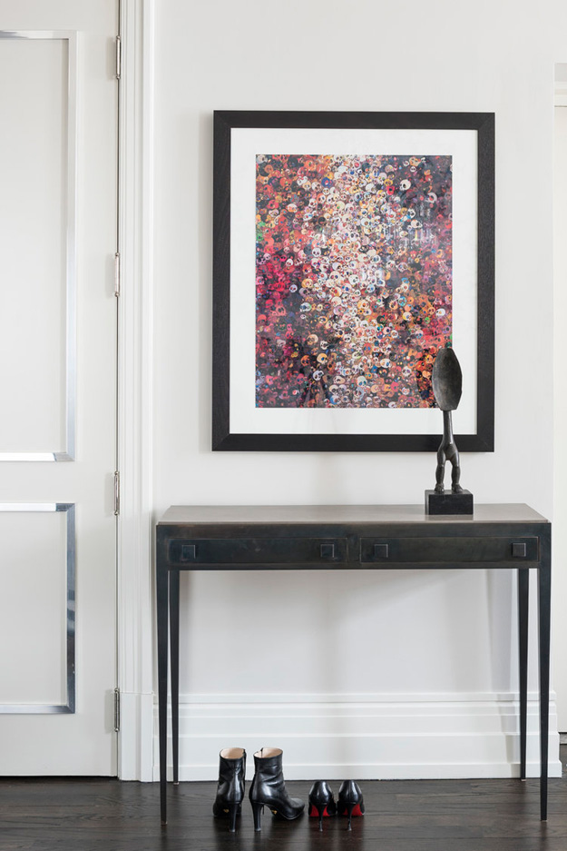 The entryway features a very bold artwork and a metal console