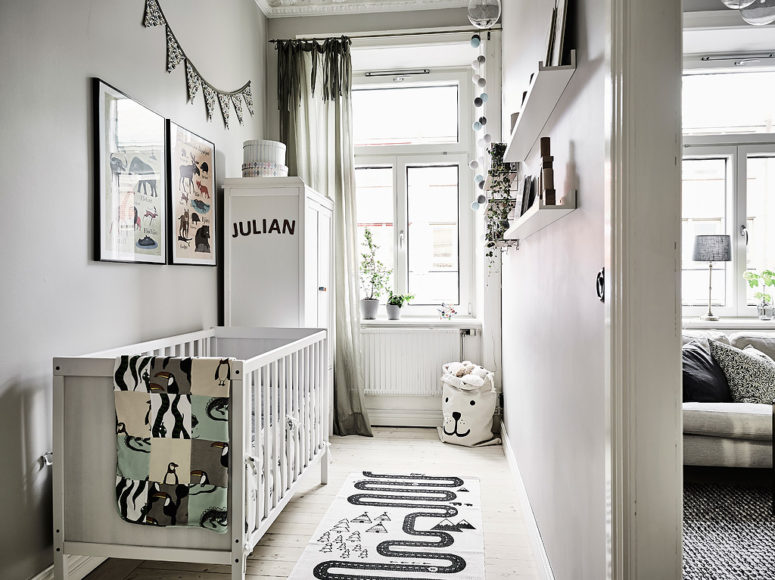 The kid's space is small, with colored artworks and textiles and a printed rug