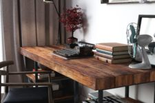 09 a cool dark stained industrial desk with blackened metal and shelves