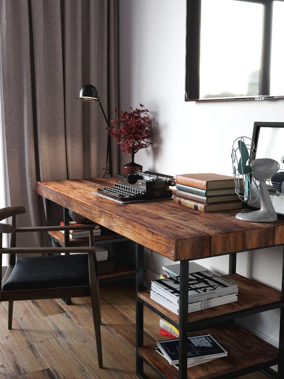 a cool dark stained industrial desk with blackened metal and shelves