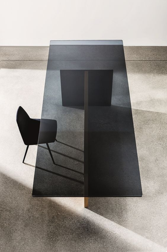 rectangular wood and black glass dining table