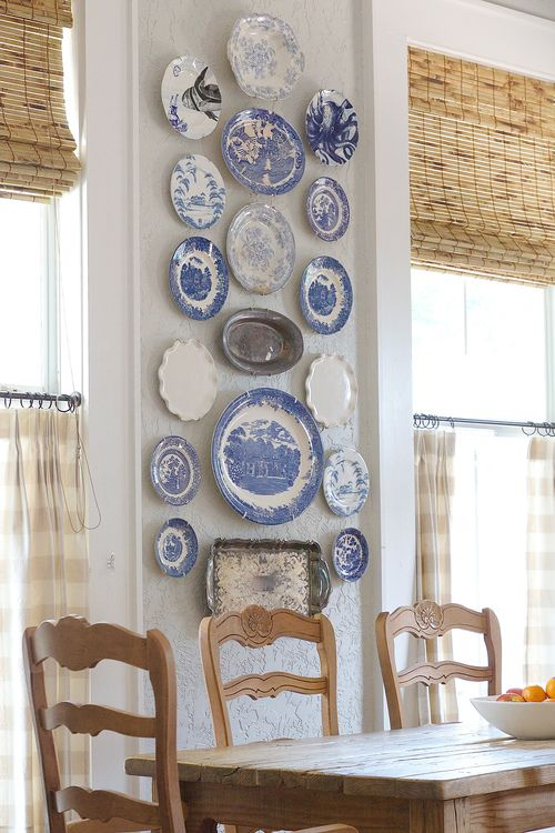 blue and white plates and silver trays for decorating a dining space