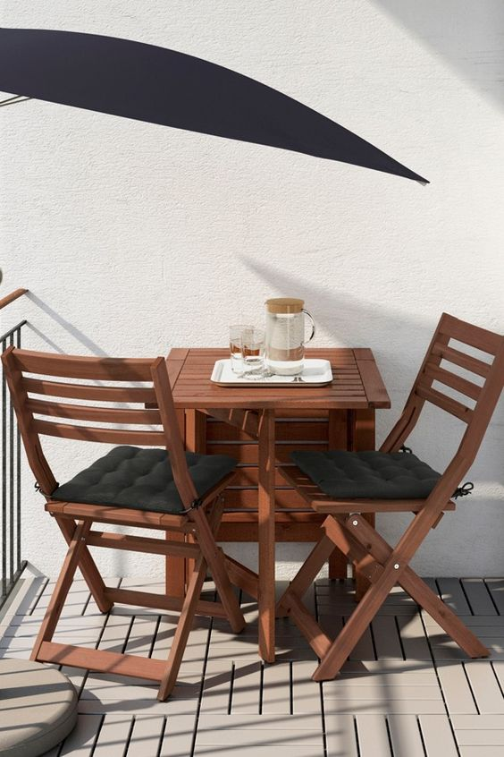 Ikea Applaro table and two folding chairs allow you to adjust the table size according to your space and needs