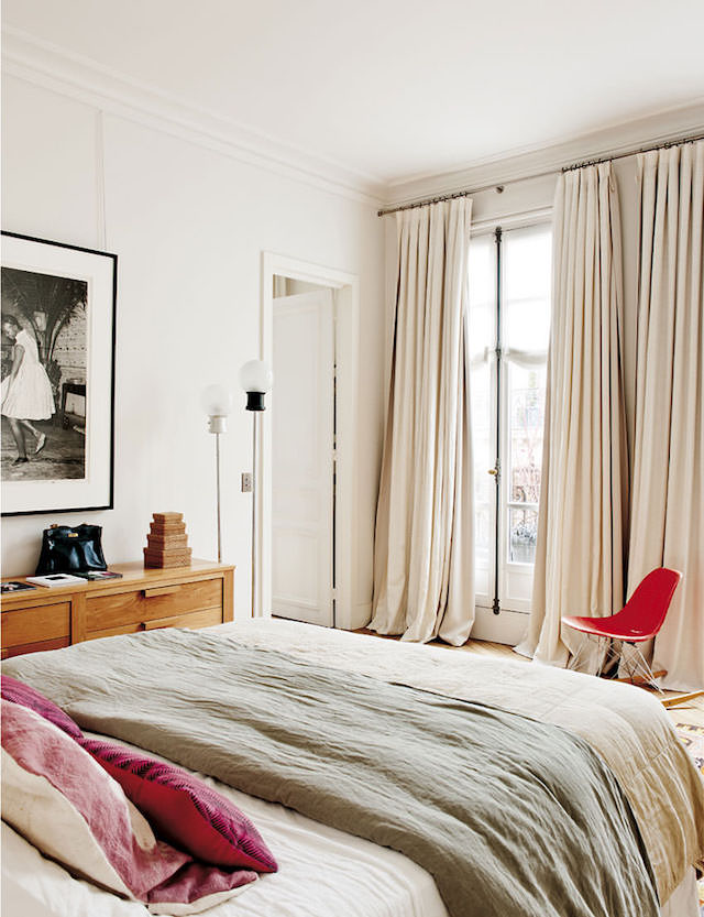 The master bedroom is very soft, creamy and inviting, with red accents