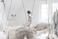 12 a hanging bed in this boho space is a very bold statement