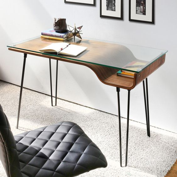 minimalist desk with a glass top and a storage spaace underneath