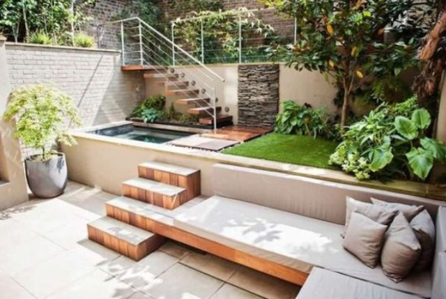a modern outdoor space with a plunge pool and a built in bench with steps
