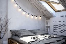 15 a reclaimed stained wooden bed with drawers gives the attic bedroom a barn feel