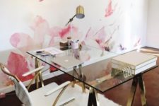 16 a glam desk with gilded sawhorse legs and a glass tabletop