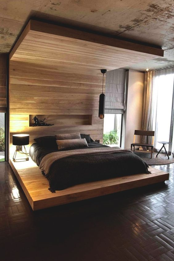a wooden podium with a headboard coming into a roof looks very dramatic