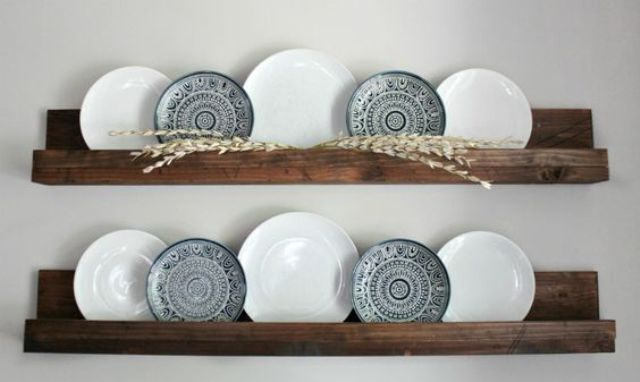 dark stained wooden shelves with plates for wall decor