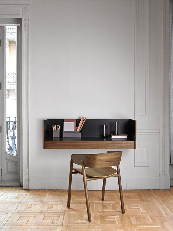 a modern floating desk with a black tabletop looks wow