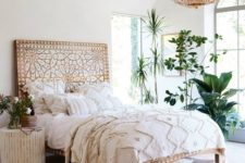 17 a wooden bed with whitewashed decor creates a boho feeel