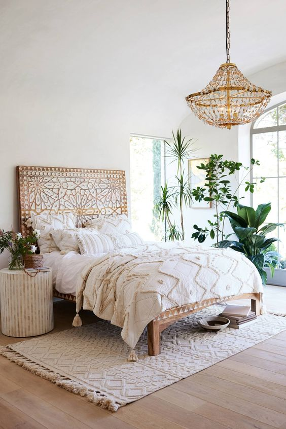 a wooden bed with whitewashed decor creates a boho feeel