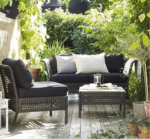 Kungsholmen lounge set with black upholstery contrasts with greenery around