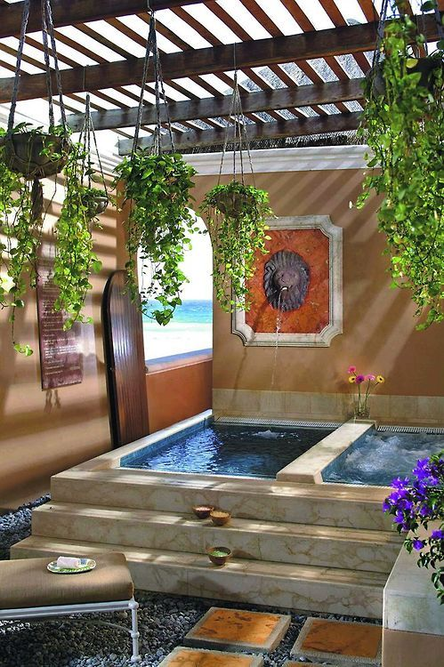 a Morocco-inspired outdoor space with two tubs - one usual and another a spa one