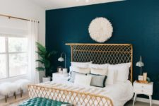 19 a woven gilded metal bed with a bent headboard looks chic