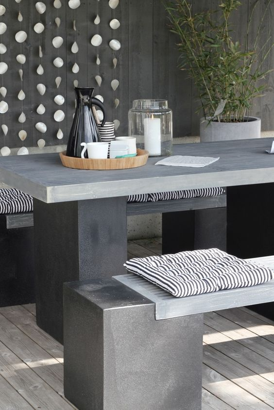insert wooden tops into concrete bases to make the benches not so cold for seating