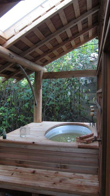 outdoor jacuzzi with a wooden deck and a roof over it gives a natural feel to the space