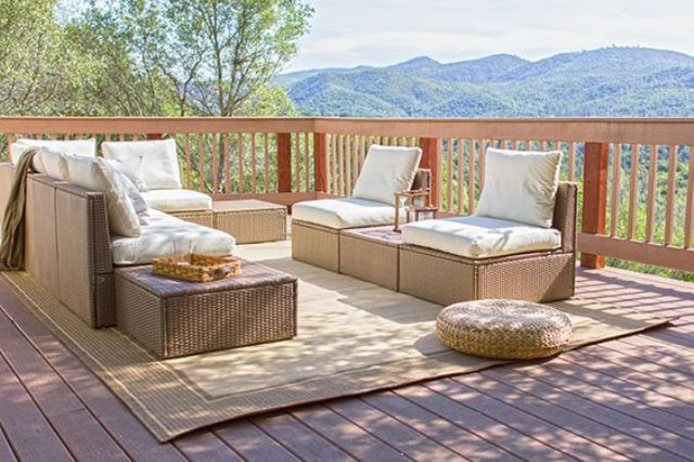 a terrace furnished with Ikea Arholma and a wicker ottoman