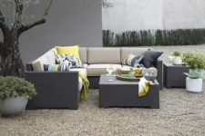 21 Arholma sectional sofa with some table and bold pillows is great for any backyard