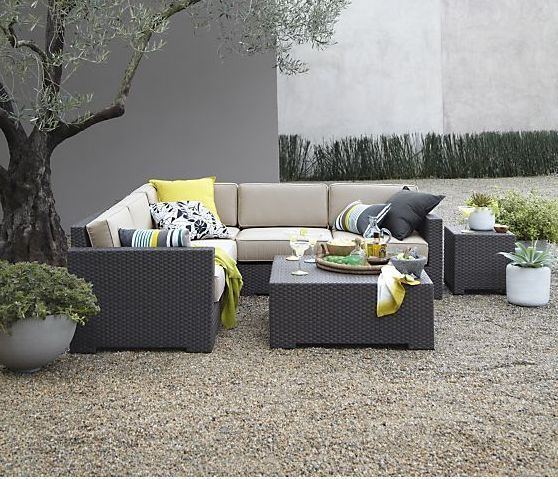 Arholma sectional sofa with some table and bold pillows is great for any backyard