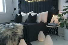 21 a black pallet bed can be DIYed and makes a bold statement in a light-colored room