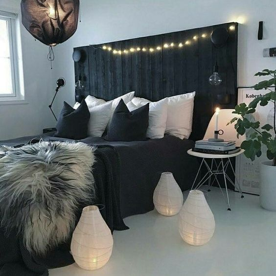 a black pallet bed can be DIYed and makes a bold statement in a light-colored room