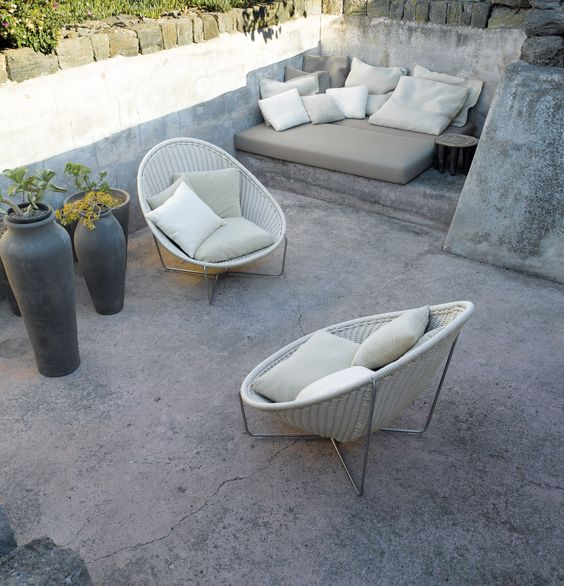 rounded white wicker chairs with creamy cushions